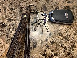 Repurposed LV fringed key ring